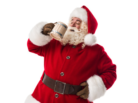 Santa Claus drinking beer Closeup Portrait Isolated on White Background Stock Photo
