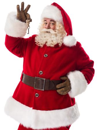 keys: Santa Claus holding keys Closeup Portrait Isolated on White Background Stock Photo