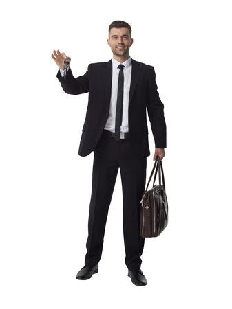 keys isolated: Businessman holding keys and bag Full Length Portrait Isolated on White Background