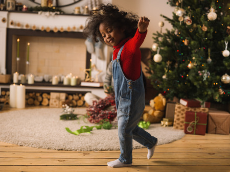 mixed race children: Little African Girl at Home with Christmas Interior