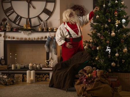 home decorating: Santa Claus Decorating Christmas Tree at Home
