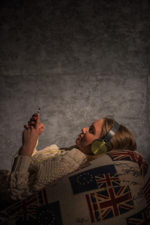 beanbag: Girl Listening Music on Beanbag at home