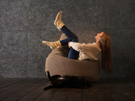 beanbag: Girl with her Cat on Beanbag at home