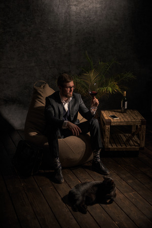 beanbag: Business man Drinking Wine at home while sitting on beanbag