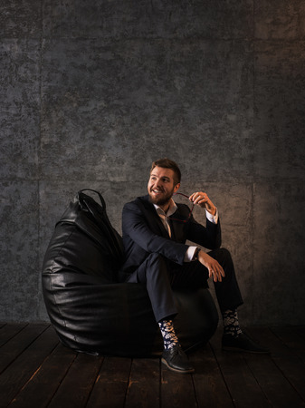 beanbag: Businessman Portrait. Sitting at Office on Beanbag and Smiling Stock Photo