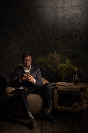 beanbag: Business man Texting Message at home or office while sitting on beanbag