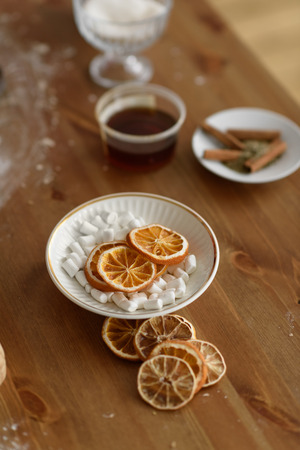 Dry Oranges and Marshmallow on table