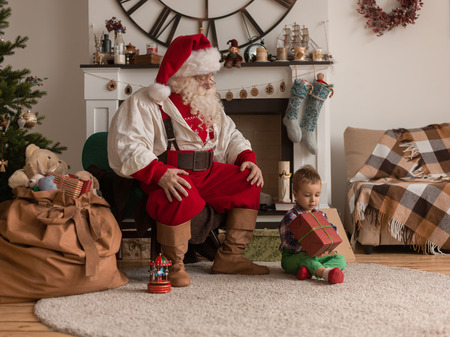 Santa Claus with Child at Home