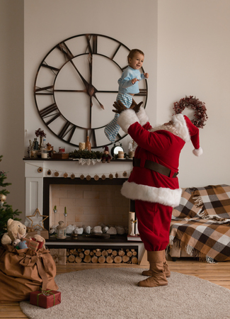 Santa Claus Playing at Home with Child