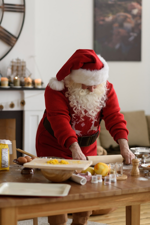 Santa Claus Cooking at Home Christmas Cookies Stock Photo