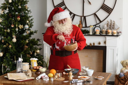 Santa Claus Cooking at Home Christmas Cookies Imagens