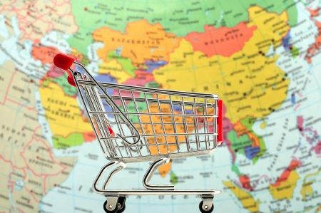 A shopping trolley with a blured background of Asia map photo