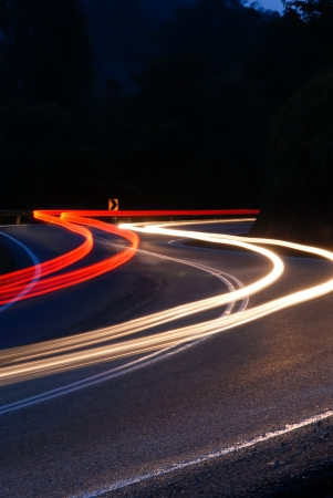 shutter: Lights from vehicles head light and tail light creating light trail when captured using slow shutter. Stock Photo