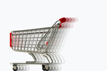 super market: A miniature shopping trolley in fast moving effect using multiple layer image