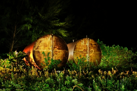 rusted: 2 rusted oil tank shot using