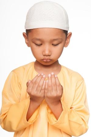 A Malay muslim boy wearing islamic attire photo