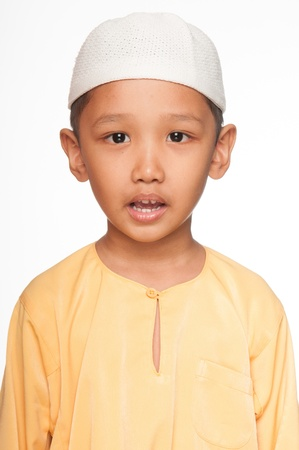 A Malay muslim boy wearing islamic attire photo