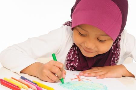 colo: A Malay little girl colouring a book Stock Photo