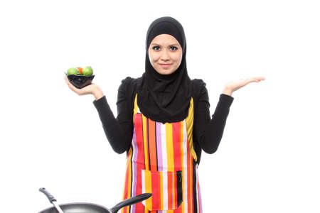 Muslim woman smiling happy presenting with open hand palm on white photo