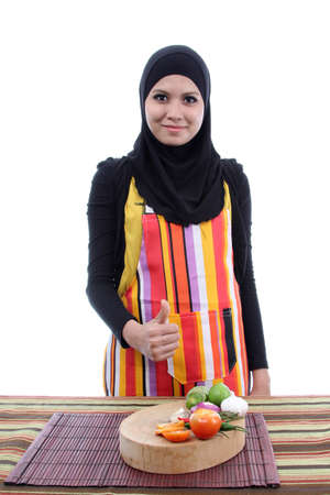 Young Muslim Women with a fresh vegetables concept on white