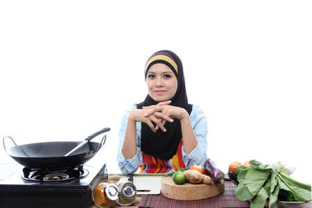 asian chef: Young Muslim Women Ready To Cook with smile on white Stock Photo