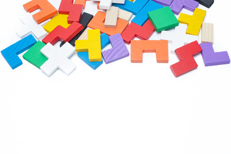 colorful wooden puzzle over white background with copy space for text