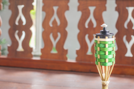 bamboo oil lamp icon of Ramadan over decorative wooden