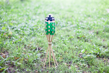 bamboo oil lamp icon of Ramadan over green grass background