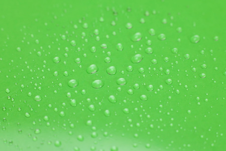 water drops on green background.selective focus