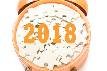 2018 written on puzzle on orange clock over white background Stock Photo