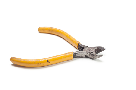 Wire cutter pliers with yellow handles isolated on white background
