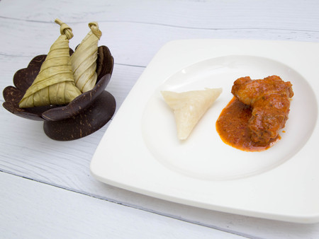 Ketupat or packed rice dumpling with chicken curry . Delicious and popular tradition