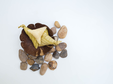 hand on Ketupat or packed rice dumpling. Delicious and popular tradition