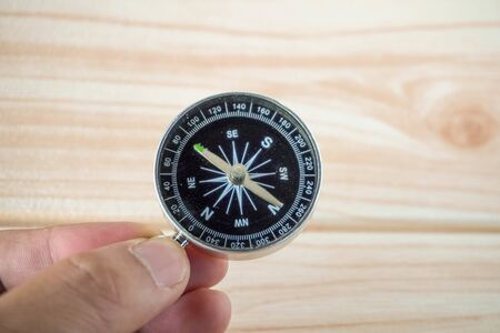 old dusty compass on hand