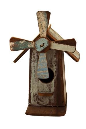 Handmade wooden birdhouse isolated on white background photo