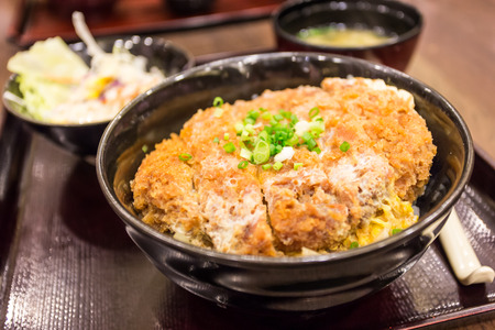 Katsudon - Japanese breaded deep fried pork cutlet  tonkatsu  topped with egg on steamed rice