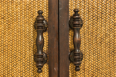 Wood Door handles and bamboo stick cross photo