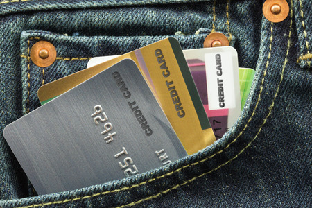 credit cards in blue jeans pocket photo