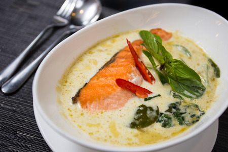 fish culture: Kang kiaw wan  Green curry with grilled salmon  in white bowl