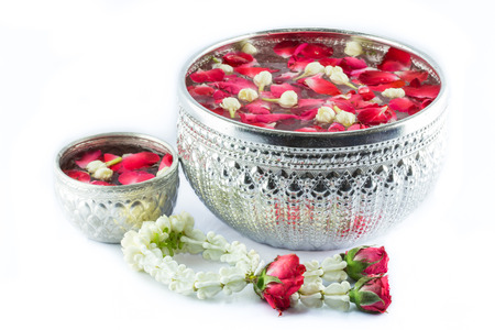 Thai garland Flowers and Water with jasmine and roses corolla in bowl isolated on white background (Use for Songkran festival in Thailand) Stock Photo