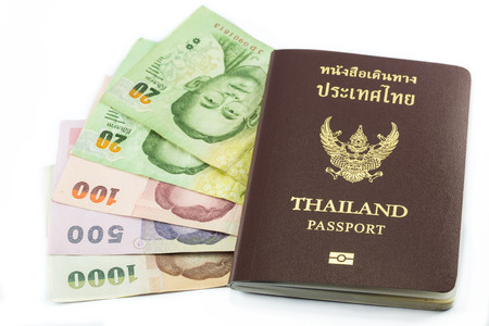 Thailand passport with Thai money ready to travel isolated on white background photo