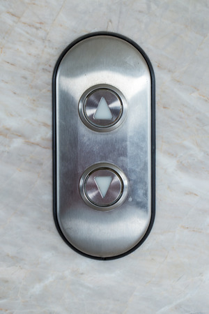 stuck up: Gray Elevator Button up and down direction on marble wall