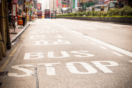 Bus stop sign close-up at Hong Kong with vintage filter