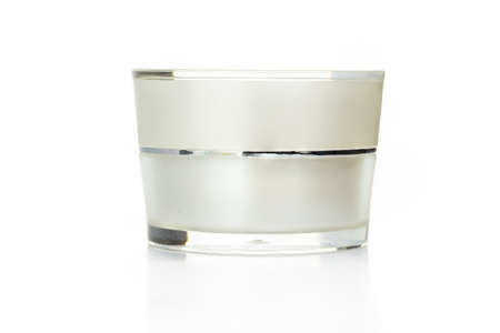 Blank cream cosmetic container isolated on white background