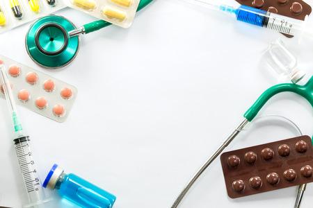 Medical frame of Stethoscope pill ampoules and syringe isolated on white background photo