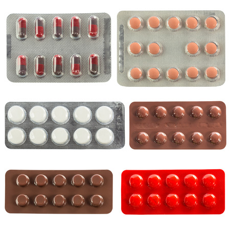collection of pills in transparent blister packs isolated on white background photo