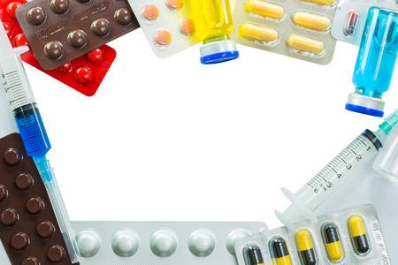 Medical frame of Stethoscope pill ampules and syringe isolated on white background photo