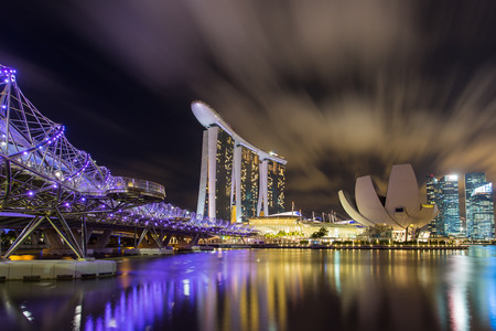 marina bay sand: SINGAPORE - JAN 29, 2015: The Helix Bridge and Marina Bay Sand hotel and artscience museum Editorial
