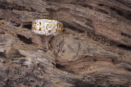 Heart shape diamond ring on old wood texture photo