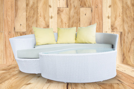 bamboo stick: sofa furniture weave bamboo stick chair with yellow pillows on wooden wall